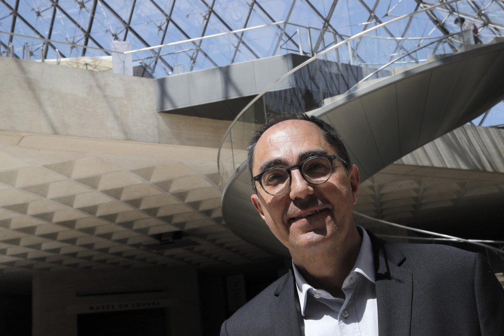 President-Director of the Louvre museum Jean-Luc Martinez poses during a visit of the Louvre museum ahead of its reopening next July 6, in Paris, Tues...