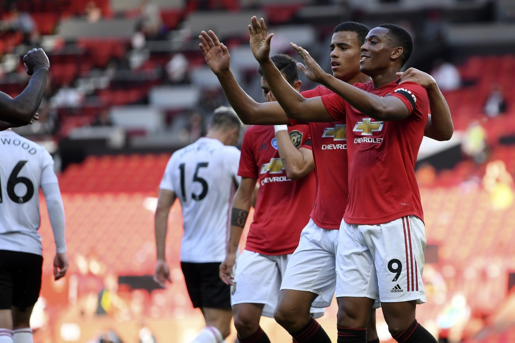 Manchester United's Anthony Martial, right, celebrates with his teammates after scoring his side's second goal during the English Premier League socce...