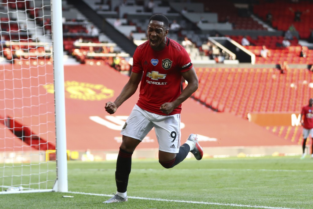 Manchester United's Anthony Martial celebrates after scoring his side's third goal during the English Premier League soccer match between Manchester U...