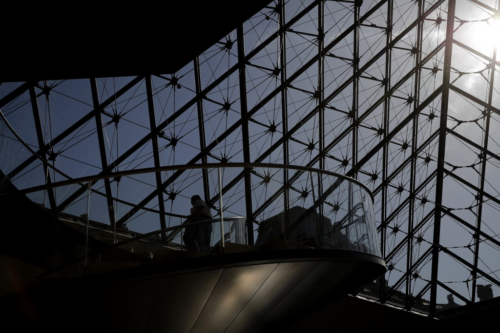 A guards goes down the stairs during a visit of the Louvre museum as part of its reopening next July 6, in Paris, Tuesday, June 23, 2020. Before mass ...