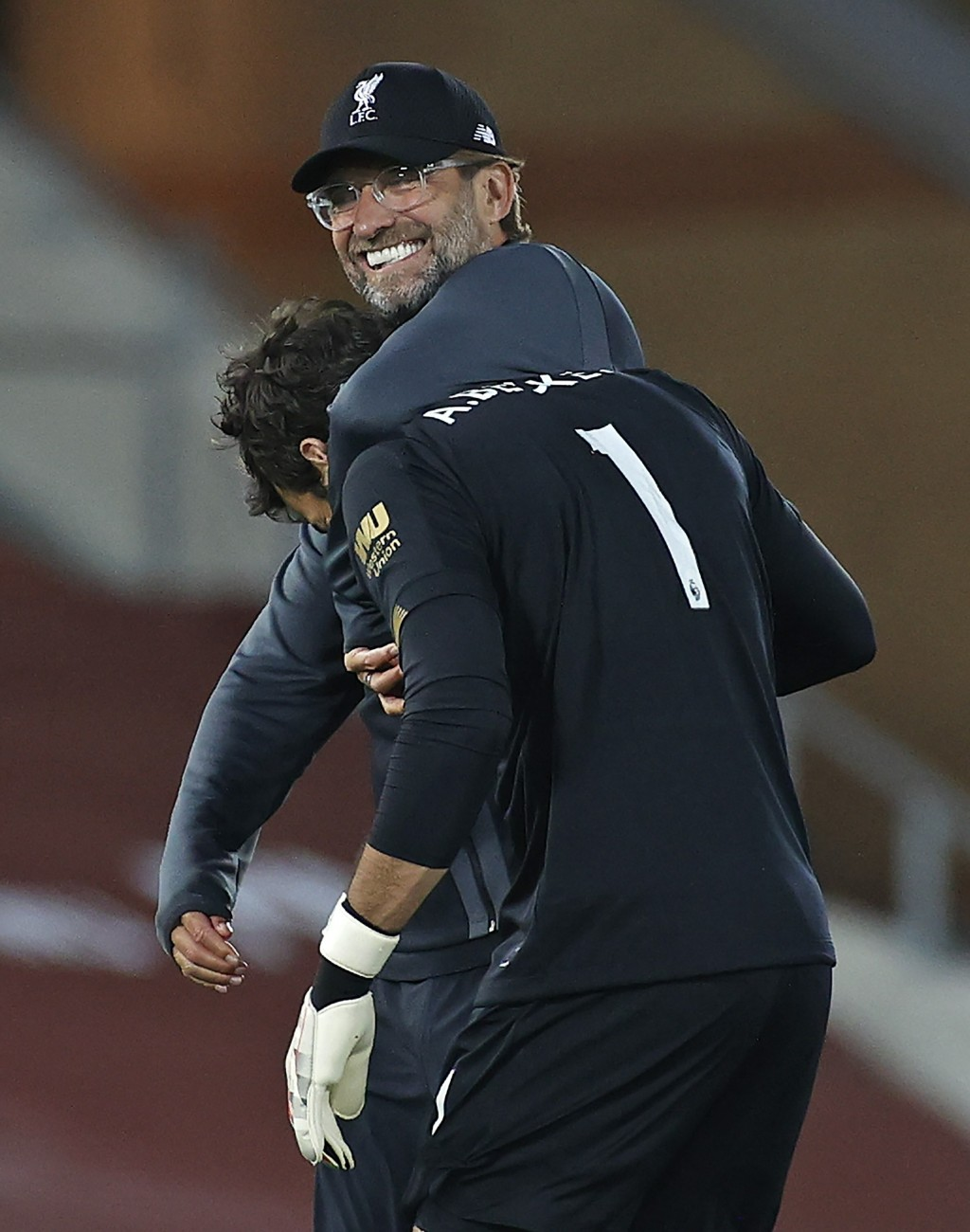 Liverpool's manager Jurgen Klopp celebrates with Liverpool's goalkeeper Alisson after the English Premier League soccer match between Liverpool and Cr...