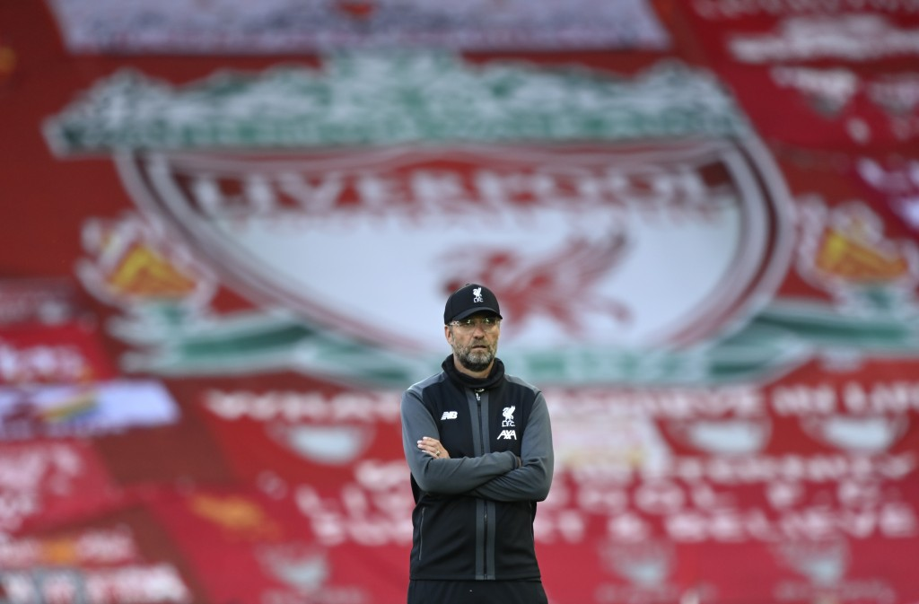 Liverpool's manager Jurgen Klopp stands on the pitch before the English Premier League soccer match between Liverpool and Crystal Palace at Anfield St...