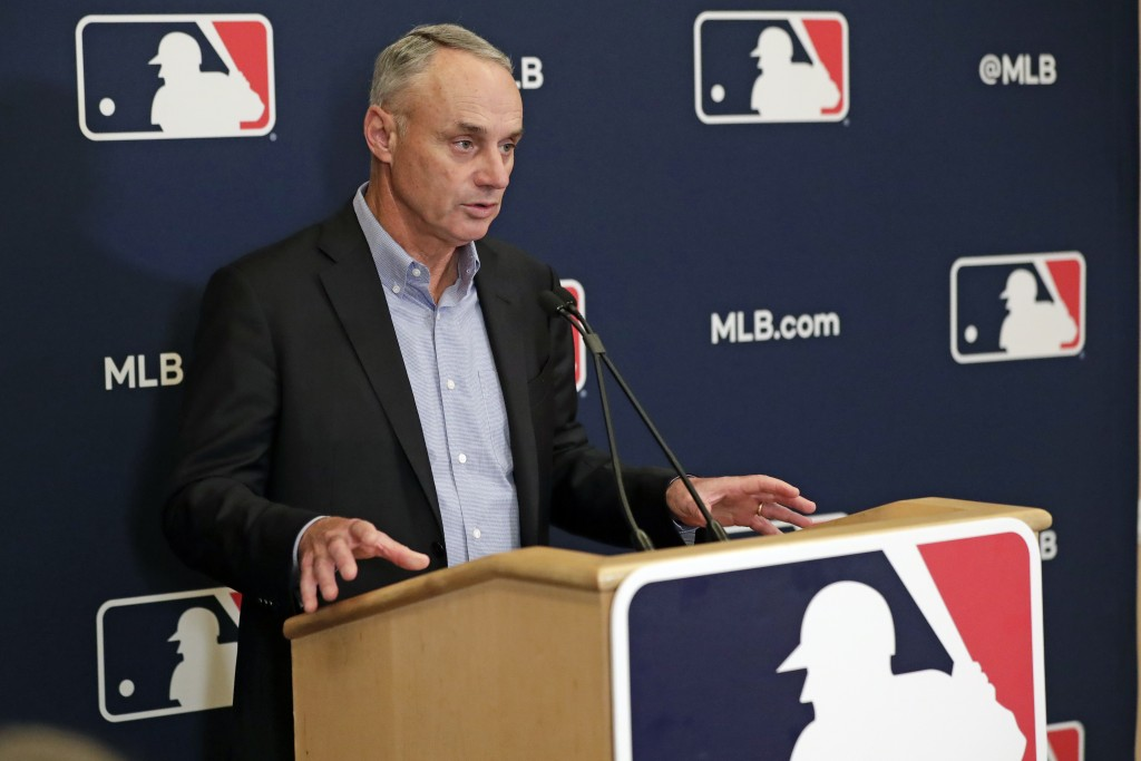 FILE - In this Feb. 6, 2020, file photo, Baseball Commissioner Rob Manfred answers questions at a press conference during baseball owners meetings in ...