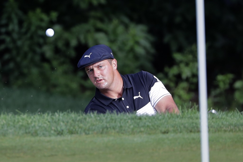 Bryson DeChambeau chips on the 10th green during the first round of the Travelers Championship golf tournament at TPC River Highlands, Thursday, June ...