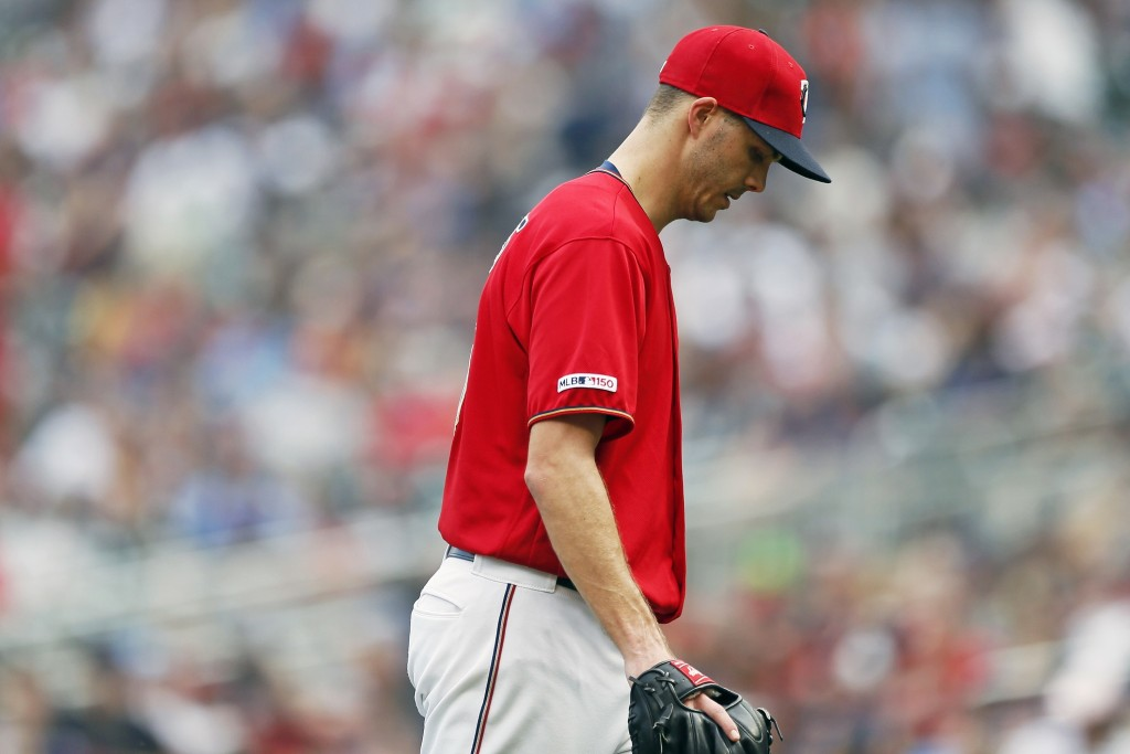 FILE - In this Aug. 11, 2019, file photo, Minnesota Twins pitcher Taylor Rogers heads to the dugout after he was pulled in the 10th inning of a baseba...