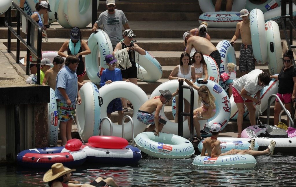 Tubers prepare to float the Comal River despite the recent spike in COVID-19 cases, Thursday, June 25, 2020, in New Braunfels, Texas. Texas Gov. Greg ...