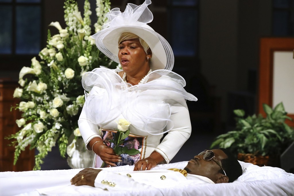 FILE - In this Monday, June 22, 2020, file photo, Tomika Miller weeps over her husband, Rayshard Brooks, as his coffin is closed at the conclusion of ...