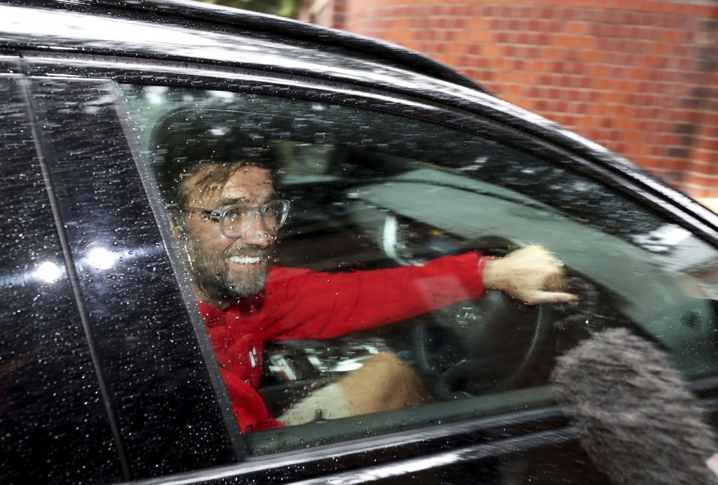 Liverpool manager Jurgen Klopp arrives at his home in Formby, Liverpool, England, Friday June 26, 2020. Liverpool clinched its first league title sinc...