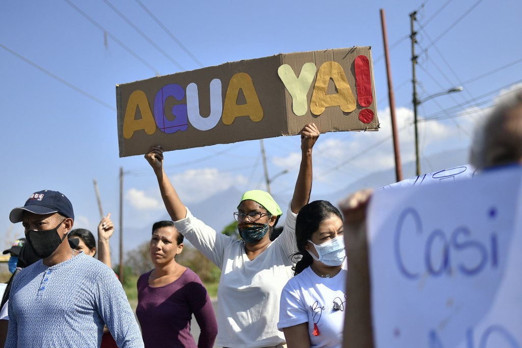 La Lira neighborhood residents protest the lack of public services including water, in Caracas, Venezuela, Thursday, May 21, 2020. An estimated 86% of...