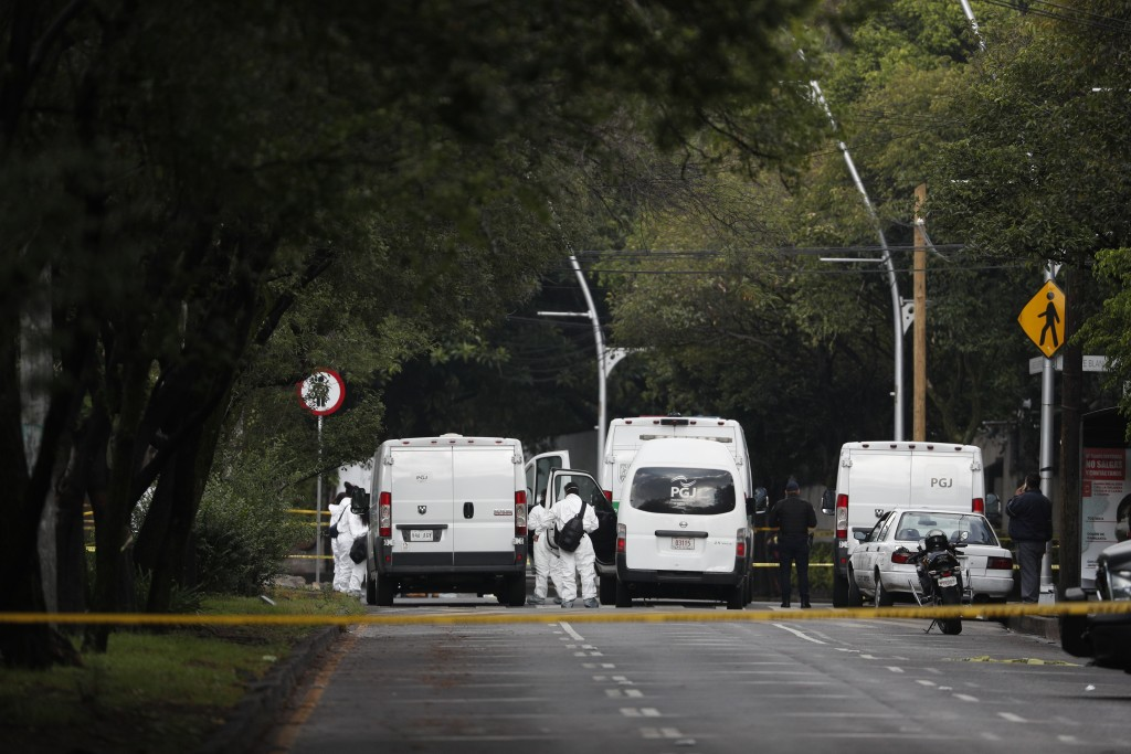 Forensic investigators and police work the scene where security secretary, Omar García Harfuch, was attacked by gunmen in the early morning hours     ...