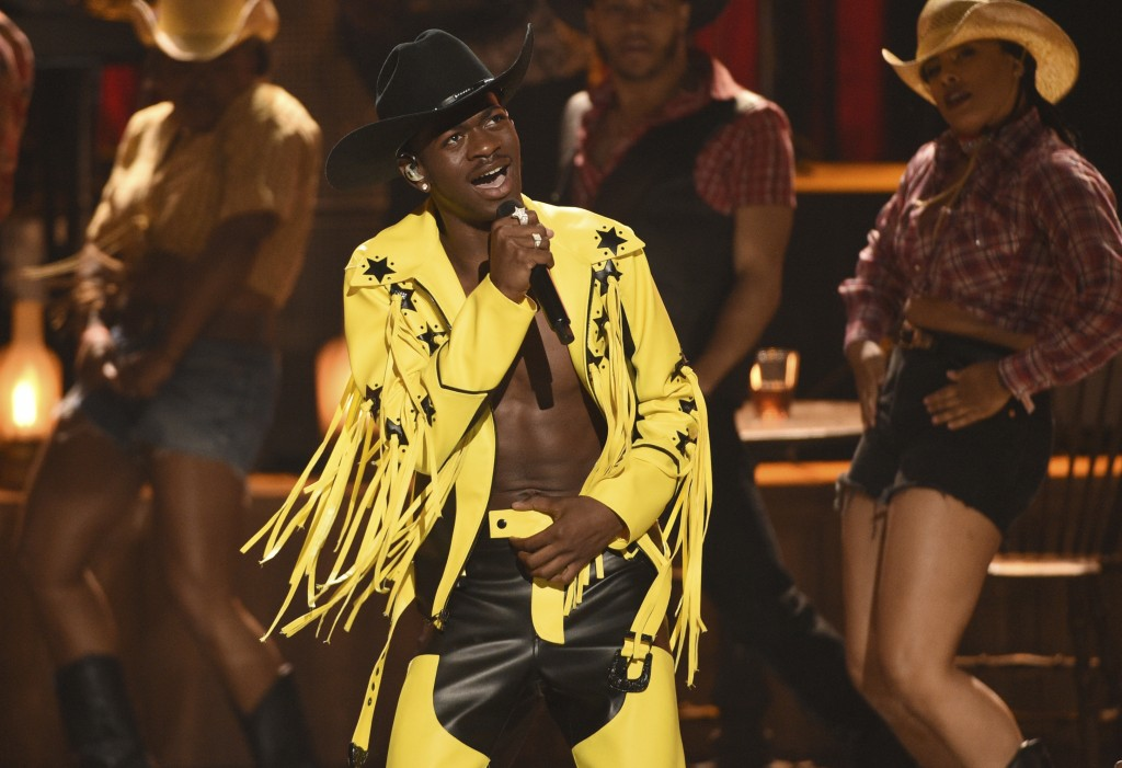 "FILE - This June 23, 2019 file photo shows Lil Nas X performing his X's genre bending ""Old Town Road"" at the BET Awards in Los Angeles. The rapper won..."