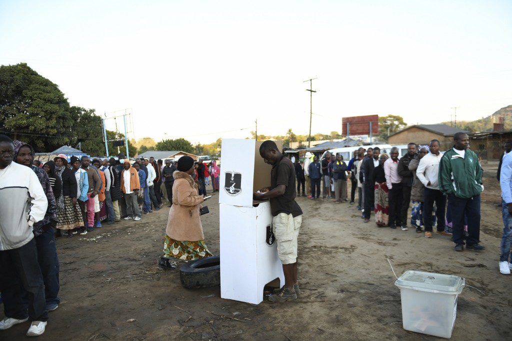 People line up to cast their votes in Blantyre, Malawi Tuesday, June 23 2020, in a rerun of the presidential poll after the courts nullified the resul...