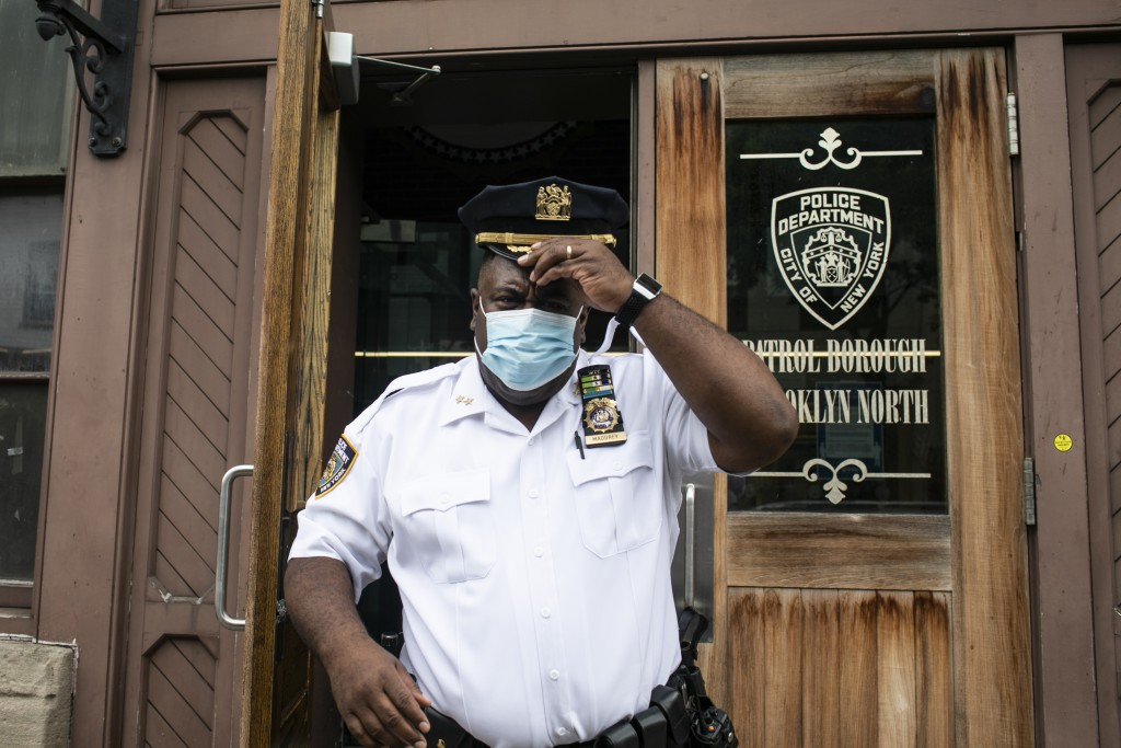 "FILE - In this June 11, 2020, file photo Assistant Chief Jeff Maddrey, leaves the Brooklyn North Patrol Borough in the Brooklyn borough of New York. ""..."