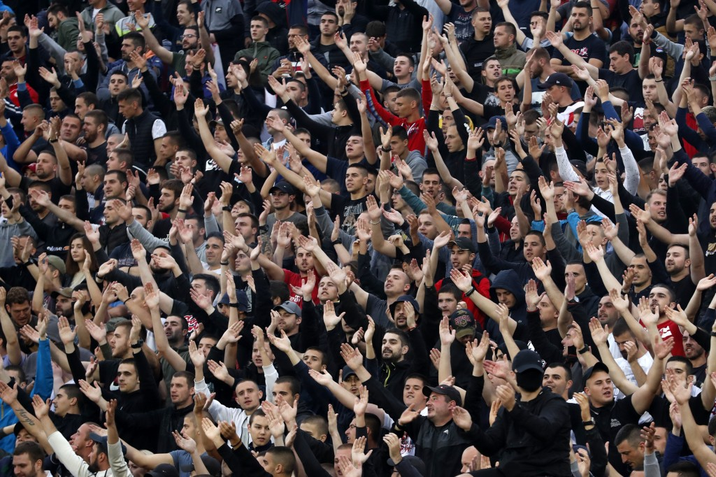 In this Wednesday, June 10, 2020. photo, Red Star fans support their team during a Serbian National Cup semi final soccer match between Partizan and R...