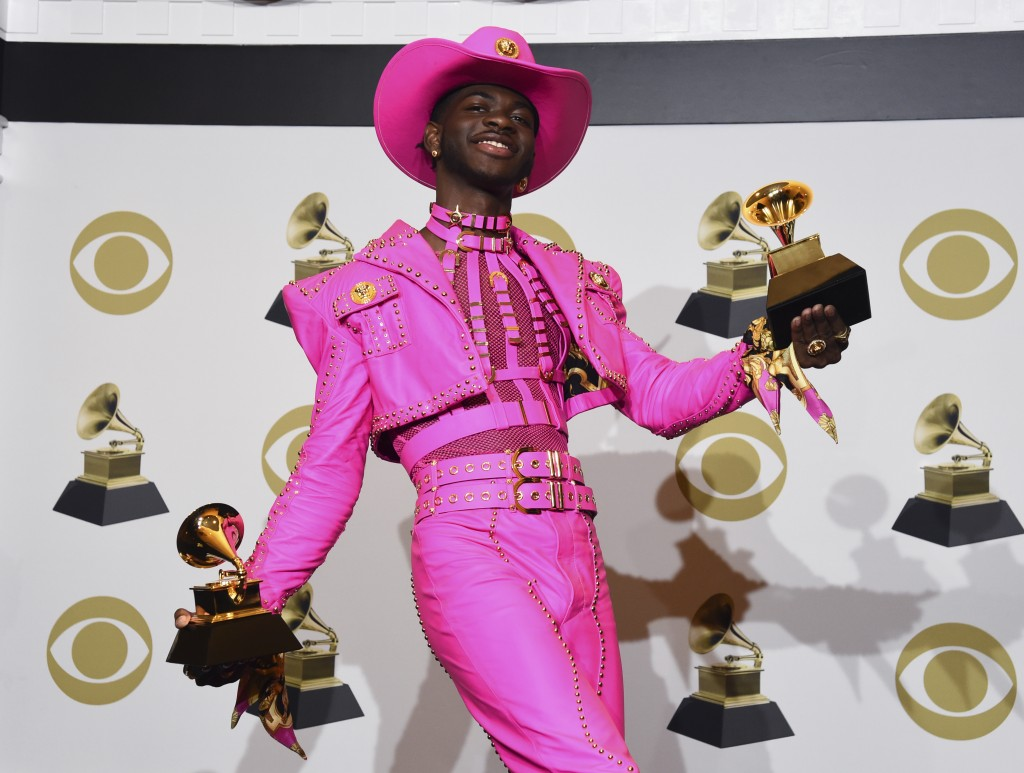 FILE - In this Jan. 26, 2020 file photo, Lil Nas X poses in the press room with the awards for best music video and best pop duo/group performance for...