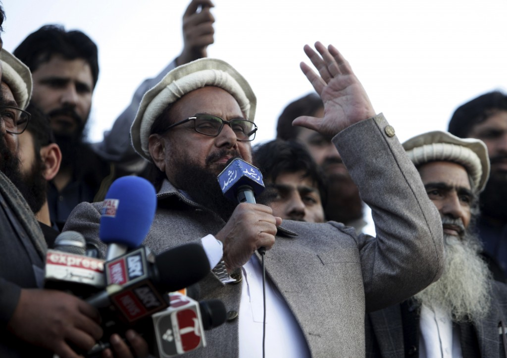 File - In this Feb. 5, 2019 file photo, Hafiz Saeed, chief of Pakistani religious group Jamaat-ud-Dawa, addresses a rally in Lahore, Pakistan. Washing...