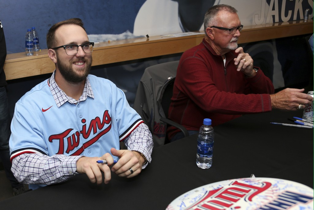 FILE - In this Jan. 24, 2020, file photo, Minnesota Twins' Randy Dobnak, left,  smiles during an autograph session at the baseball team's TwinsFest, i...