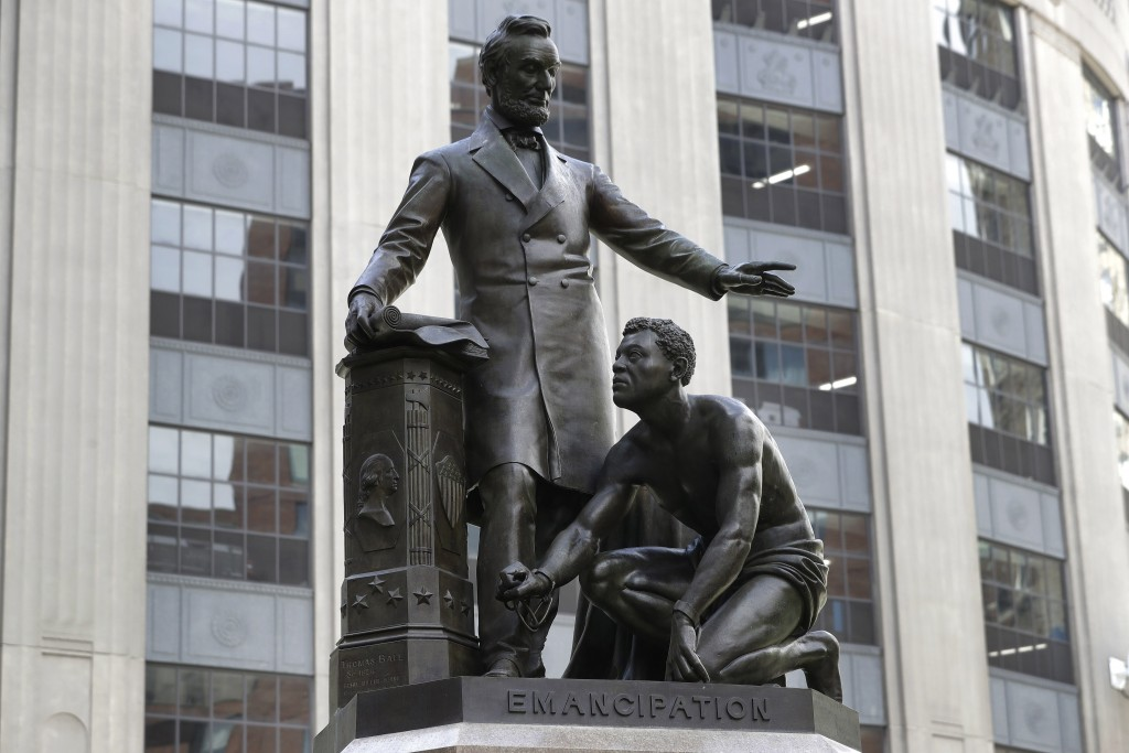 A statue that depicts a freed slave kneeling at Abraham Lincoln's feet rests on a pedestal, Thursday, June 25, 2020, in Boston. The statue in Boston i...