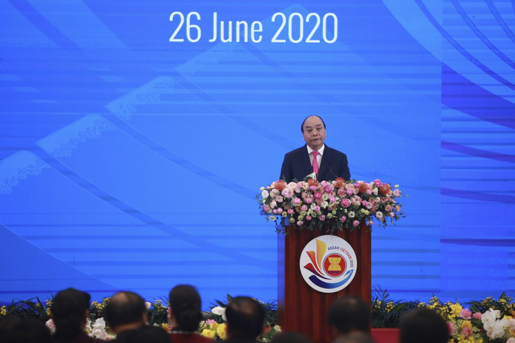 Vietnamese Prime Minister Nguyen Xuan Phuc delivers a speech at the opening ceremony of the 36th ASEAN Summit in Hanoi, Vietnam Friday, June 26, 2020....