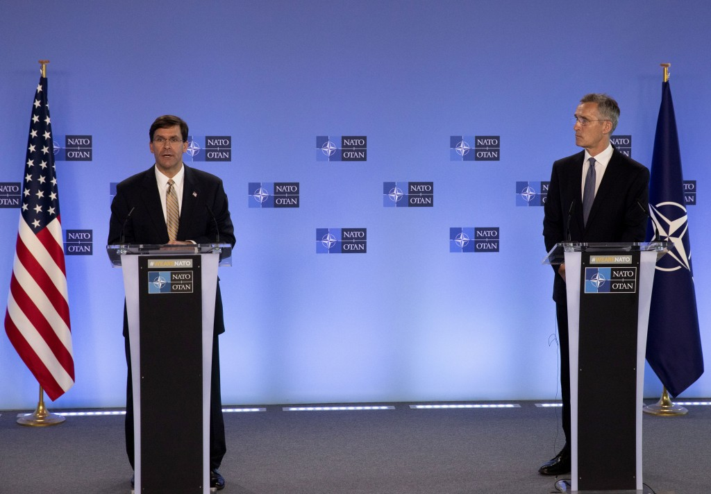 U.S. Secretary of Defense Mark Esper, left, and NATO Secretary General Jens Stoltenberg participate in a joint press conference at NATO headquarters i...