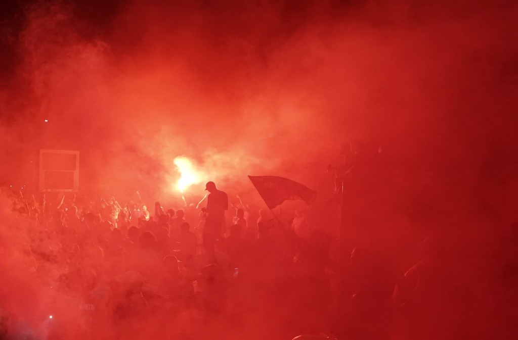 Liverpool supporters celebrate as they gather outside of Anfield Stadium in Liverpool, England, Thursday, June 25, 2020 after Liverpool clinched the E...