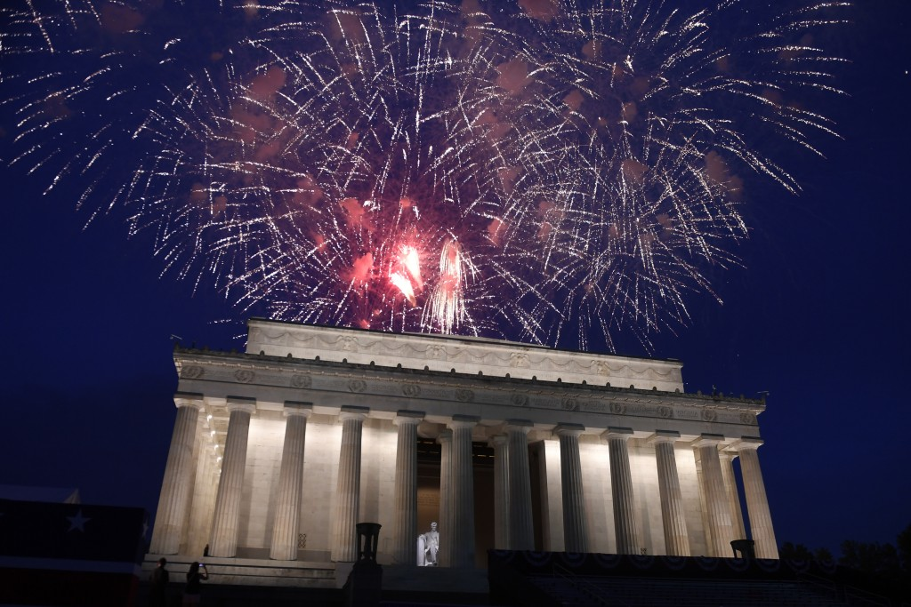 FILE - In this July 4, 2019, file photo fireworks go off over the Lincoln Memorial in Washington. Government watchdogs say President Trump's 2019 Four...