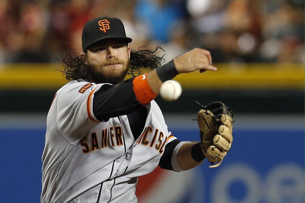 FILE - In this Aug. 17, 2019, file photo, San Francisco Giants shortstop Brandon Crawford throws in the first inning during a baseball game against th...