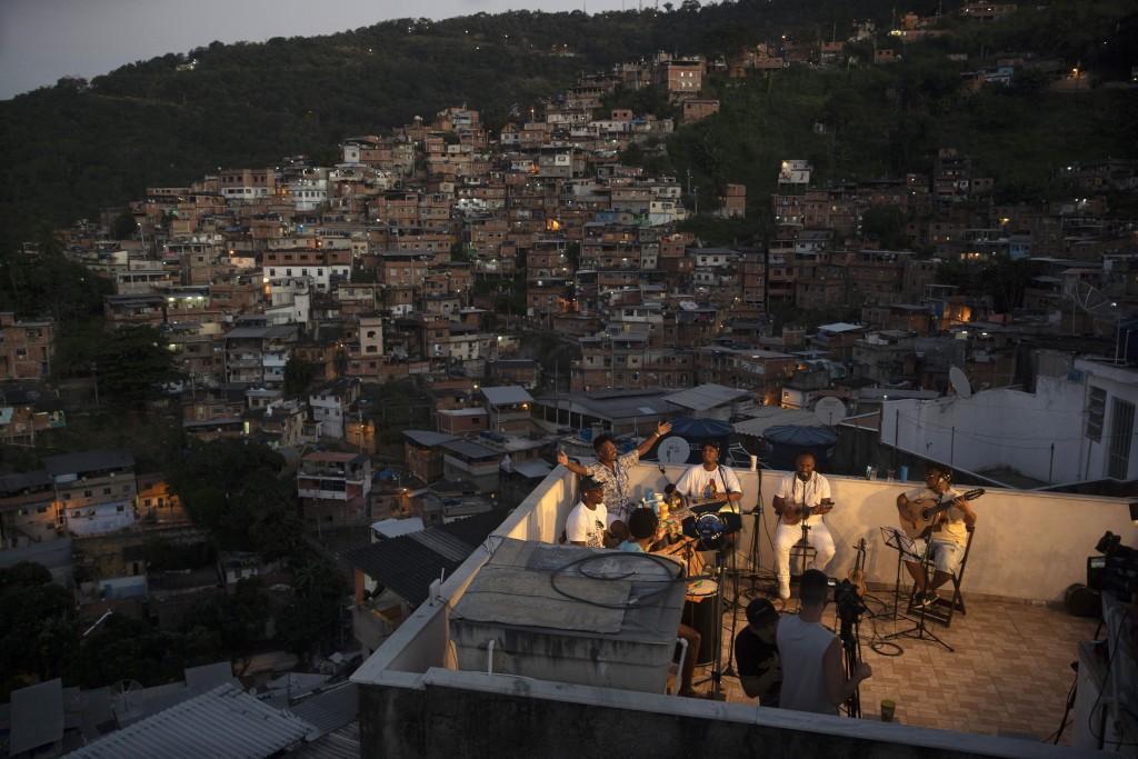 "Members of the ""Tempero de Criola"" band perform amid the new coronavirus pandemic at the Turano favela, in Rio de Janeiro, Brazil, Friday, June 19, 20..."