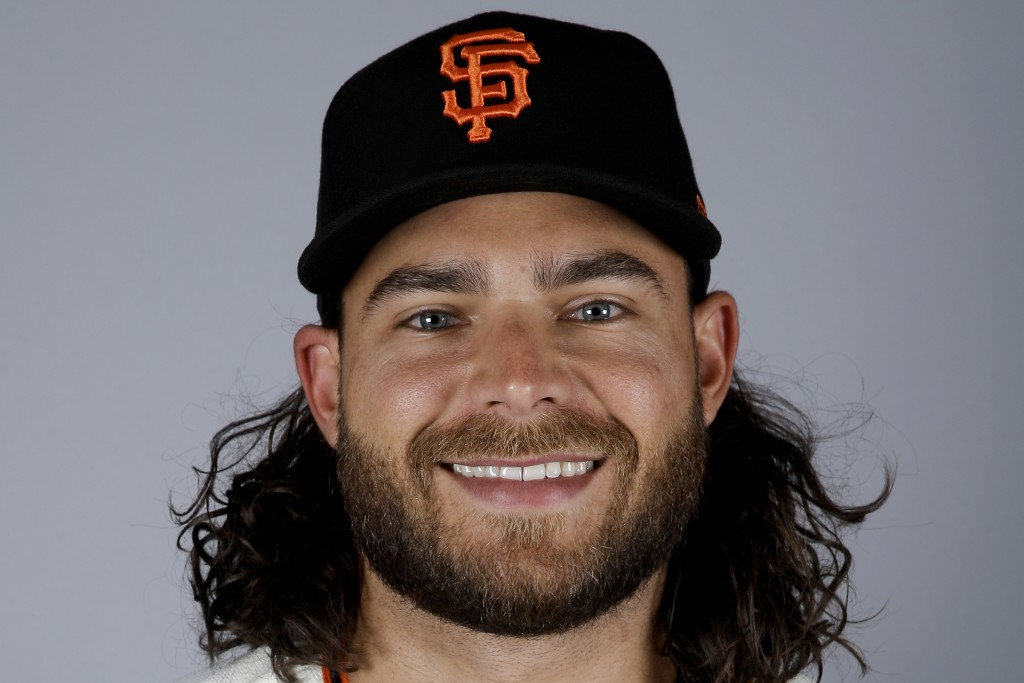 FILE - This Feb. 23, 2019, file photo, shows Brandon Crawford of the San Francisco Giants. Finally, major leaguers are on track to resume this virus-a...