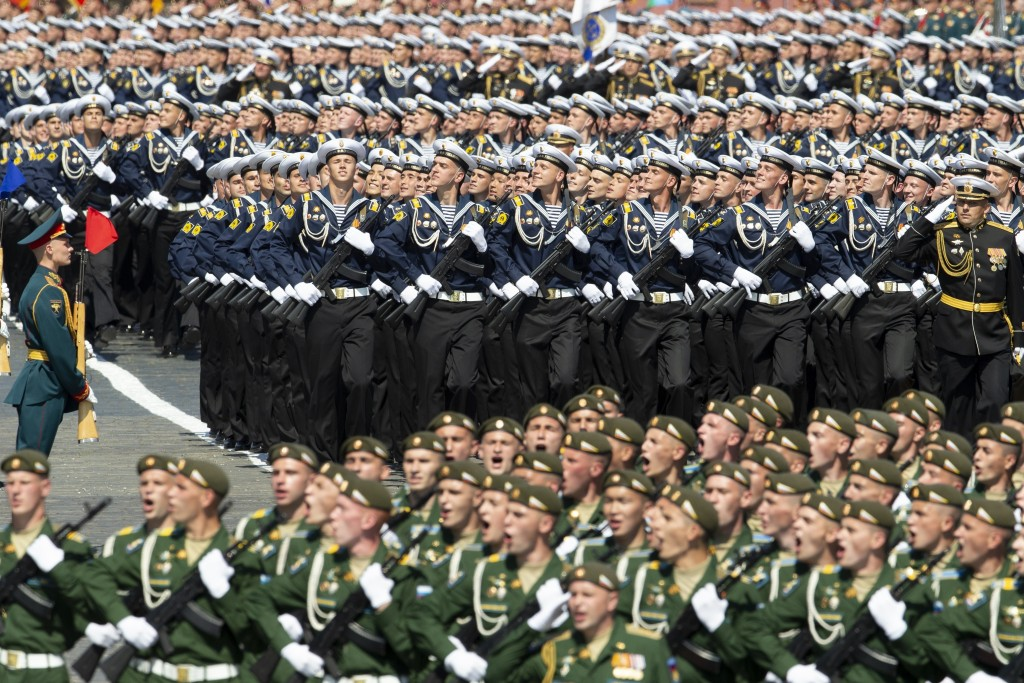 Russian sailors, center, march in Red Square during the Victory Day military parade marking the 75th anniversary of the Nazi defeat in WWII in Moscow,...