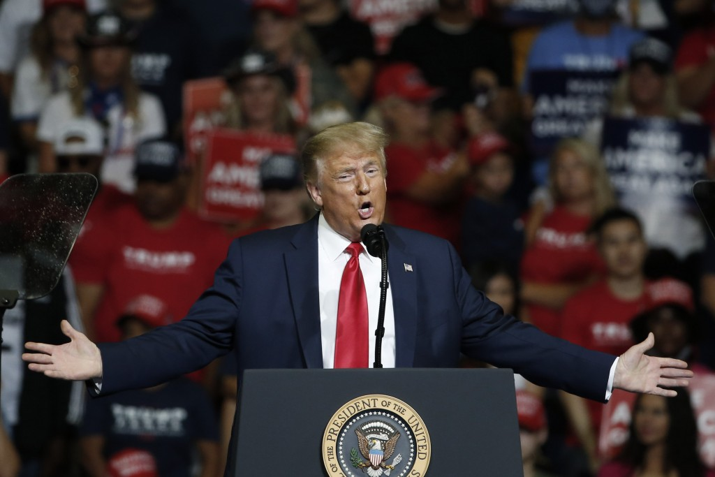 FILE - In this June 20, 2020, file photo, President Donald Trump speaks during a campaign rally in Tulsa, Okla. The coronavirus pandemic isn't going a...