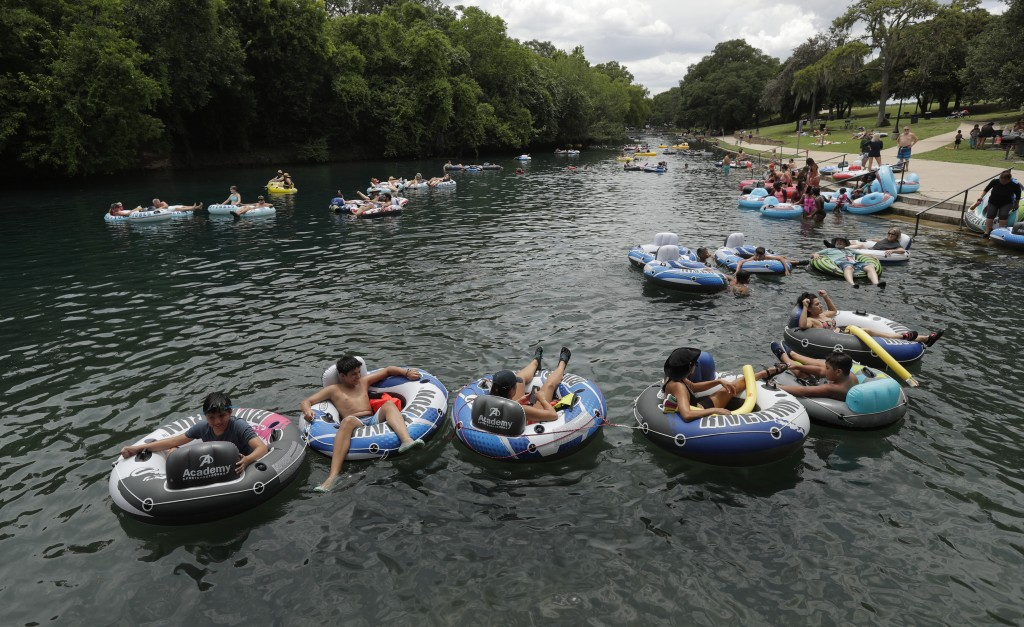 Tubers float the Comal River despite the recent spike in COVID-19 cases, Thursday, June 25, 2020, in New Braunfels, Texas. Texas Gov. Greg Abbott said...