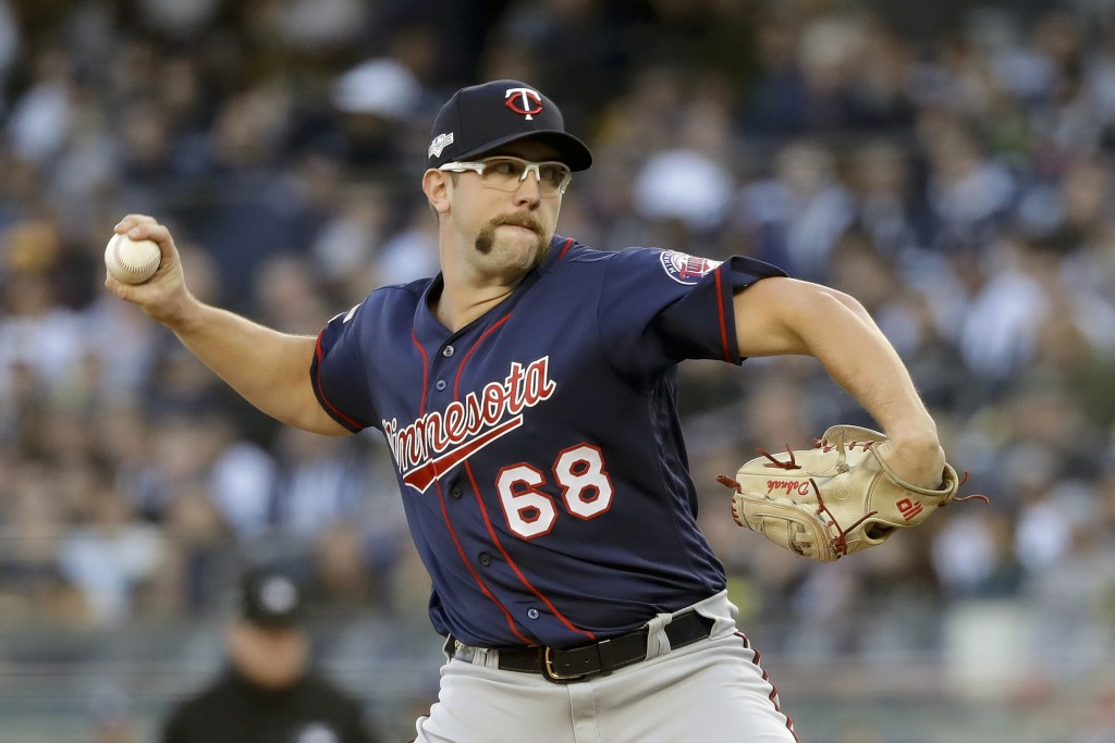 FILE - In this Oct. 5, 2019, file photo, Minnesota Twins starting pitcher Randy Dobnak (68) delivers against the New York Yankees during the first inn...