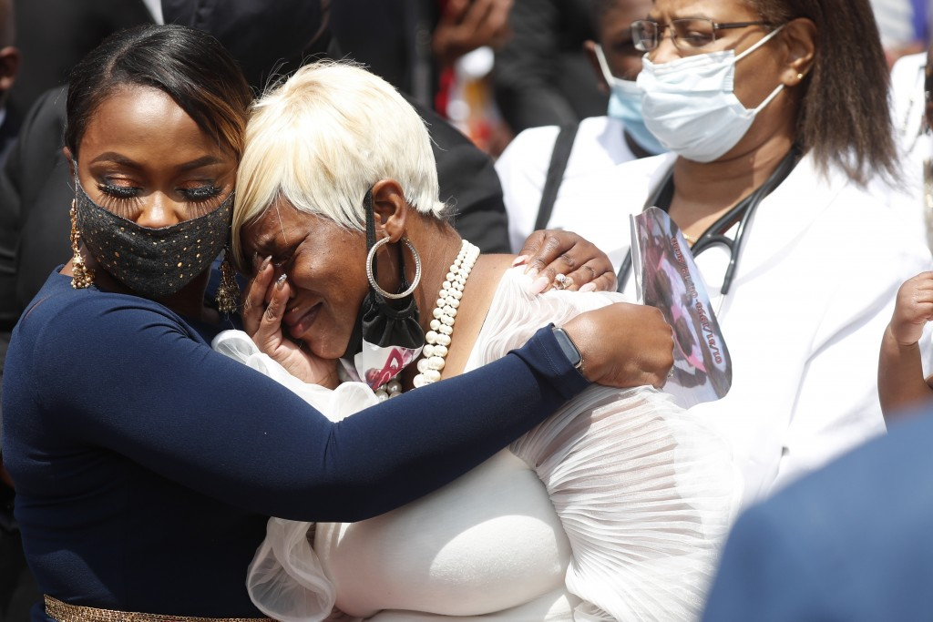 File-In this Tuesday, June 23, 2020 file photo, Tomika Miller, the wife of Rayshard Brooks, center, weeps near the entrance to Ebeneezer Baptist Churc...