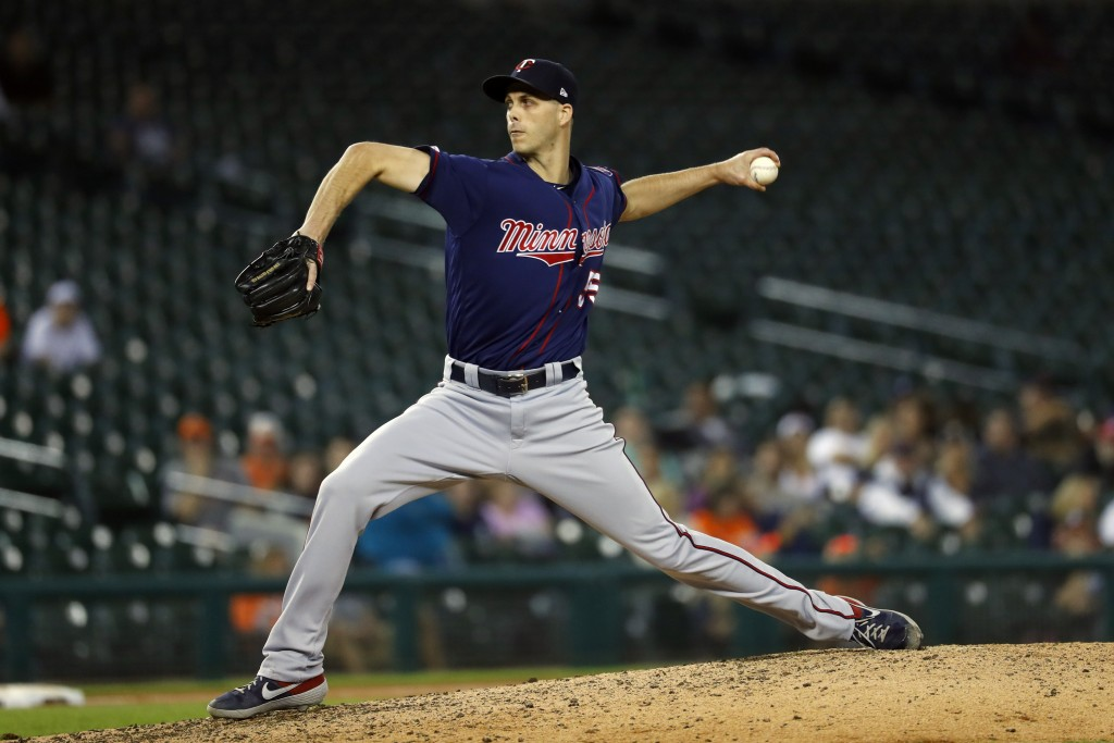 FILE - In this Sept. 24, 2019, file photo, Minnesota Twins relief pitcher Taylor Rogers throws in the ninth inning of a baseball game against the Detr...
