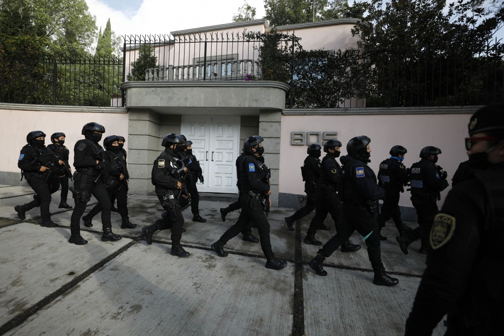 Police arrive to the scene where security secretary, Omar García Harfuch, was attacked by gunmen in the early morning hours in Mexico City, Friday, Ju...