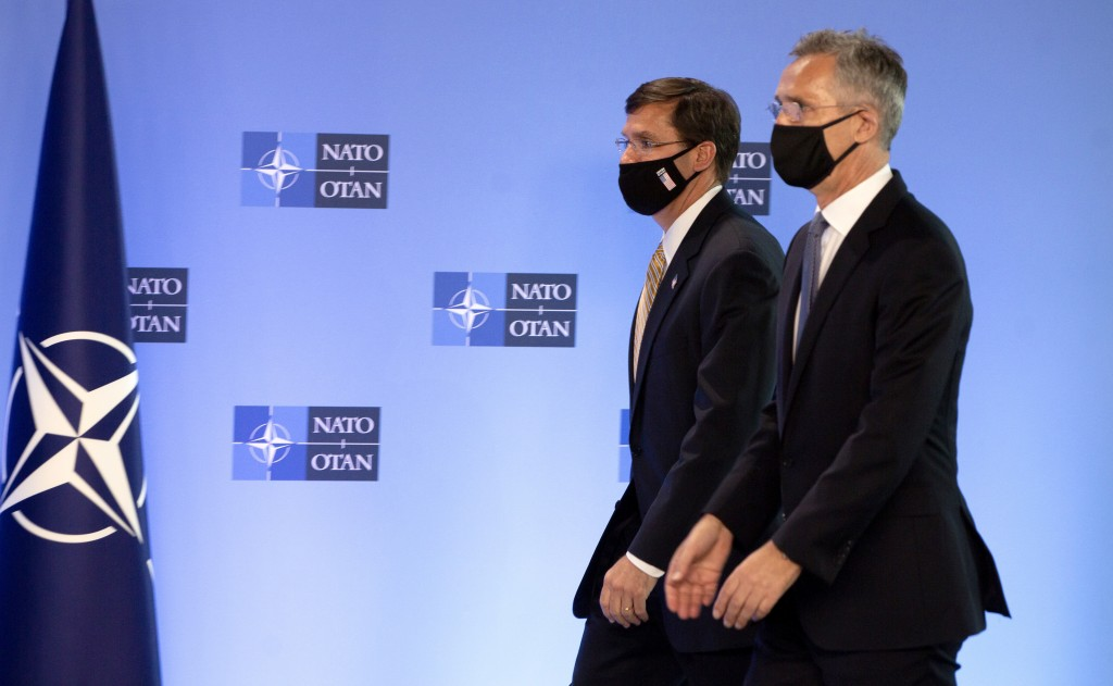 NATO Secretary General Jens Stoltenberg, right, walks with U.S. Secretary of Defense Mark Esper prior to a press conference at NATO headquarters in Br...