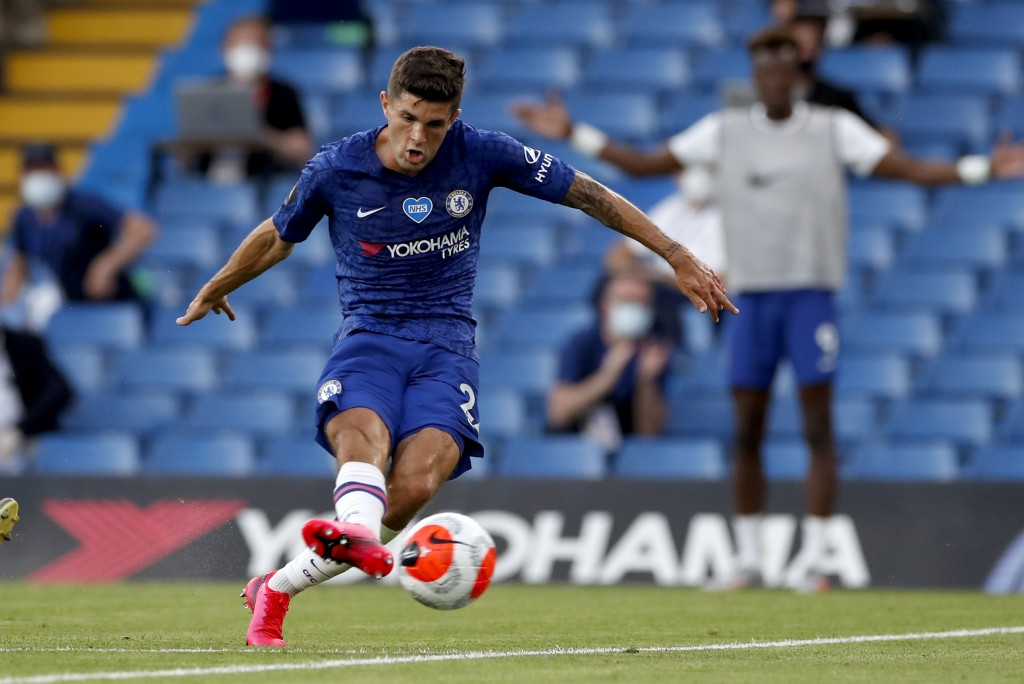Chelsea's Christian Pulisic scores his teams first goal during the English Premier League soccer match between Chelsea and Manchester City at Stamford...
