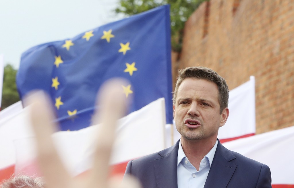 Candidate in Poland's presidential election, Warsaw centrist Mayor Rafal Trzaskowski, addresses supporters on the last day of campaigning before Sunda...