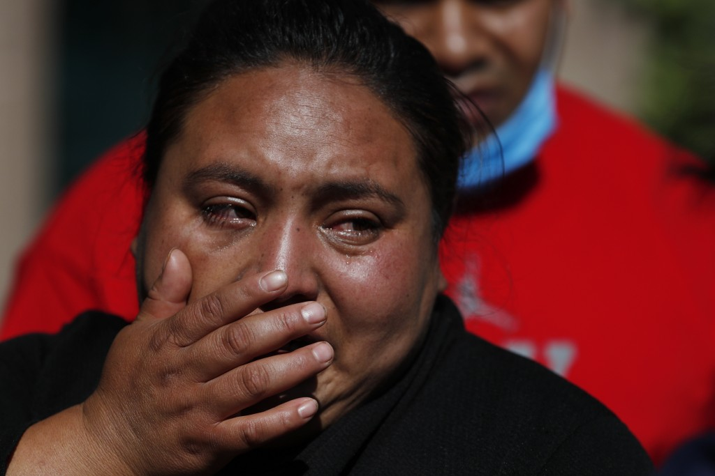 Gabriela Gomez cries after her sister Rosa Gomez was killed at the scene where police chief Omar García Harfuch was attacked by gunmen in Mexico City,...