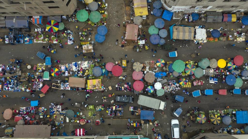 Patio umbrellas and tarps dot the landscape at La Parada market in La Victoria district, amid the new coronavirus pandemic in Lima, Peru, Tuesday, Jun...