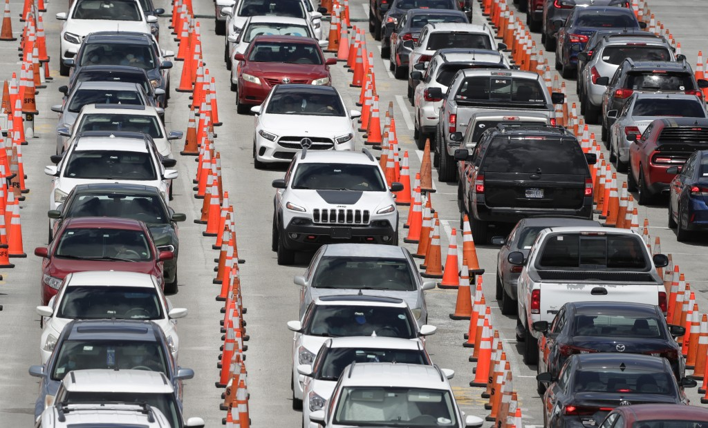 FILE - In this June 26, 2020, file photo lines of cars wait at a coronavirus testing site outside of Hard Rock Stadium in Miami Gardens, Fla. (AP Phot...