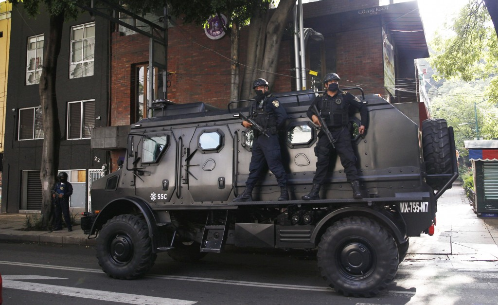 A police vehicle arrives to the place where an abandoned vehicle that is believed to have been used by gunmen in an attack against the chief of police...