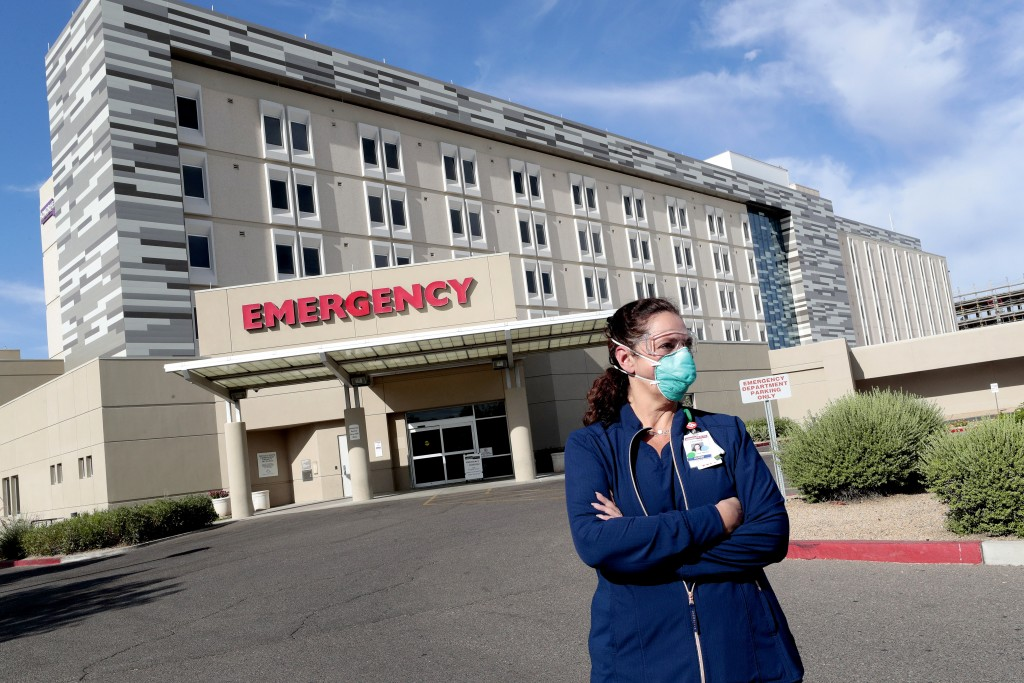 Caroline Maloney stands outside HonorHealth's Scottsdale Osborn Medical Center at the end of her overnight shift early Friday, June 26, 2020 in Scotts...