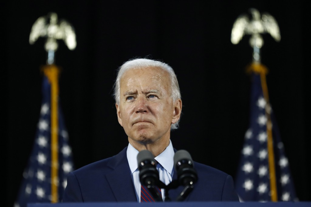 FILE - In this June 25, 2020, file photo Democratic presidential candidate, former Vice President Joe Biden pauses while speaking during an event in L...