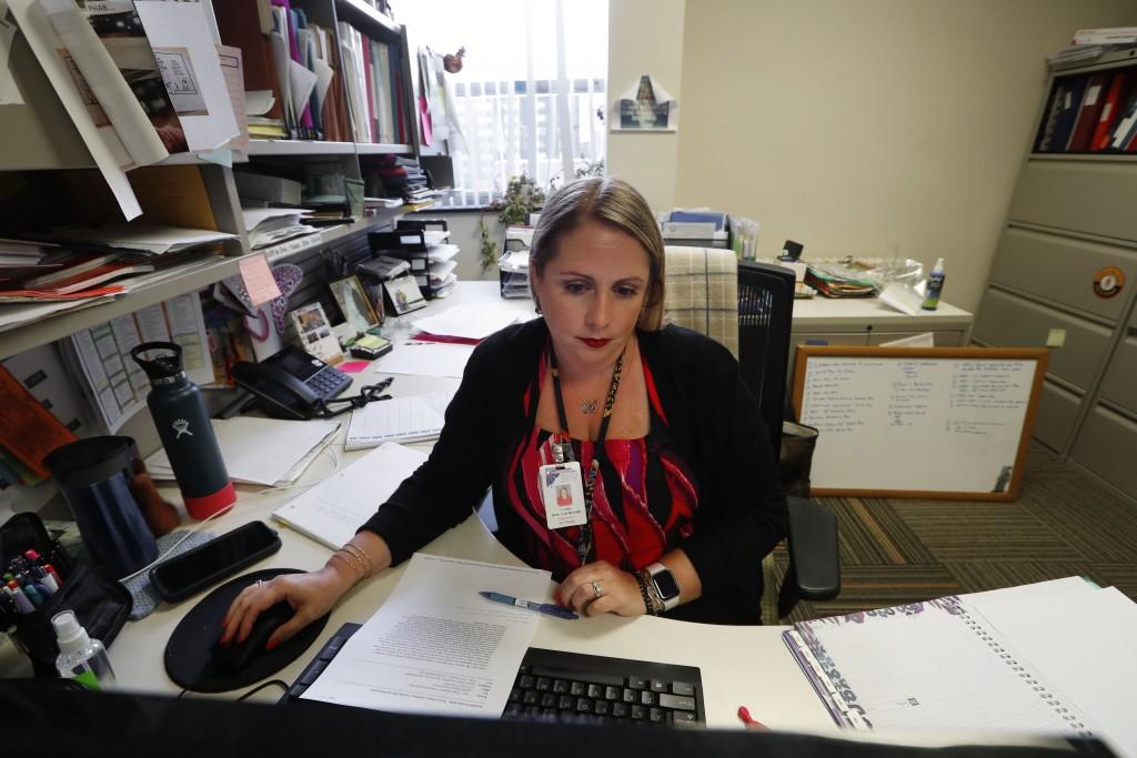 Jennifer Gottschalk, environmental health supervisor of the Toledo-Lucas County Health Department, works in her office in Toledo, Ohio, on Wednesday, ...