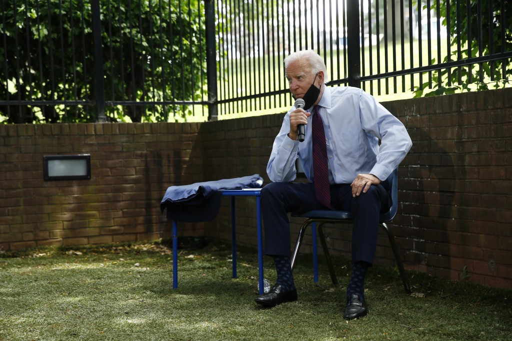 FILE - In this June 25, 2020, file photo Democratic presidential candidate, former Vice President Joe Biden speaks with families who have benefited fr...
