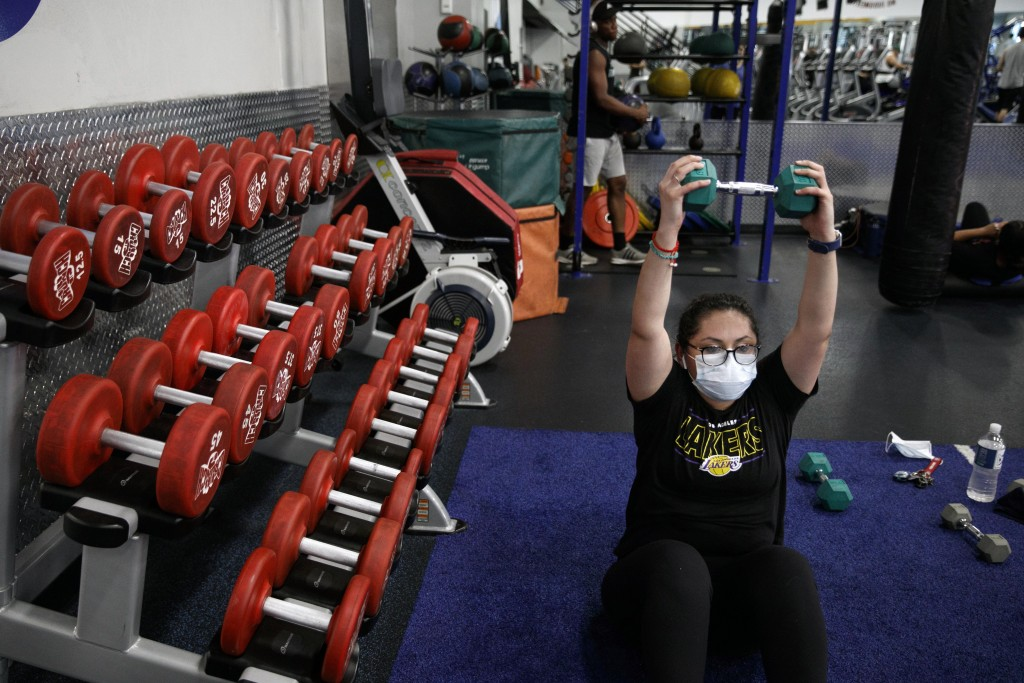 Mayra Miranda, 34, wears a mask while exercising at a gym in Los Angeles. Friday, June 26, 2020. With the coronavirus surging, at least four Californi...