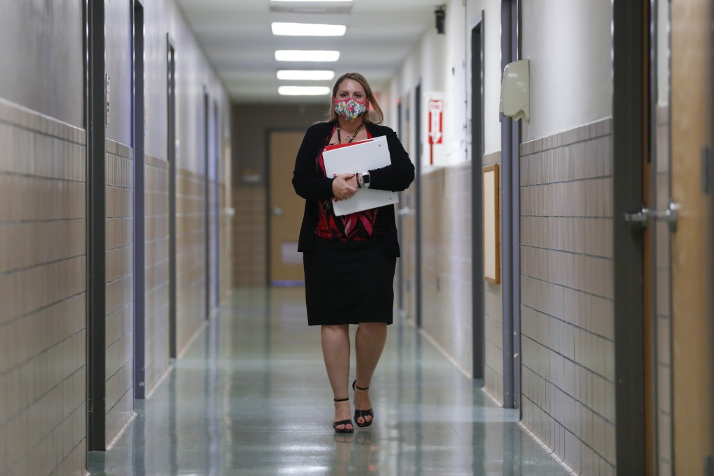Jennifer Gottschalk, environmental health supervisor of the Toledo-Lucas County Health Department, walks down a hallway of the department's offices in...