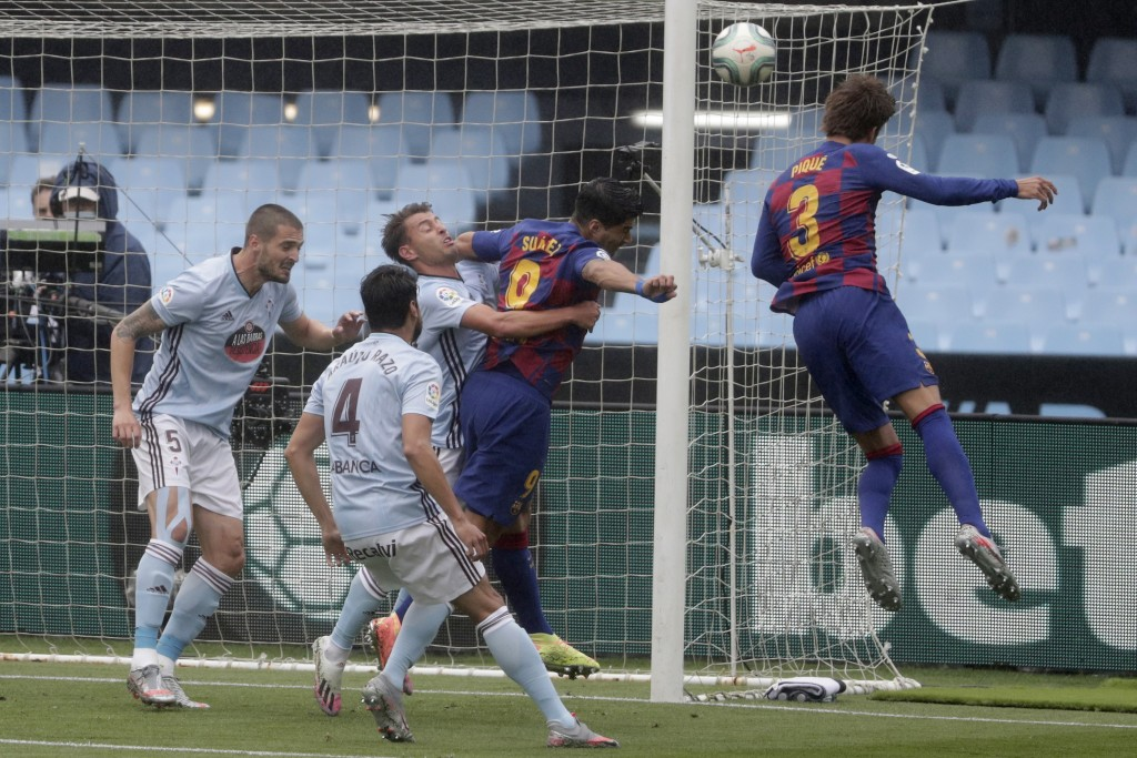 Barcelona's Gerard Pique, right, heads for the ball during a Spanish La Liga soccer match between RC Celta and Barcelona at the Balaidos stadium in Vi...